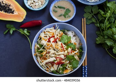 Poached chicken, cabbage and papaya salad with rice noodles and coriander