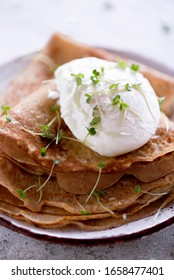 poached egg with crepes and microgreens