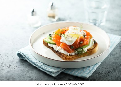 Poached egg on toast with smoked salmon and avocado