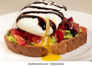 Poached egg on wholewheat toast with avocado and tomato salsa