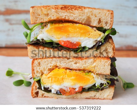 Poached eggs sandwich for breakfast.