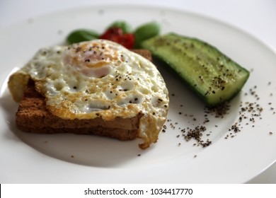 Poached eggs sandwich , fried eggs with cucumber  and tomato