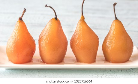 Poached pears in rose wine on the plate