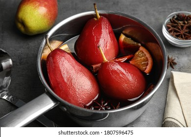 Poaching pears in mulled wine on table, closeup