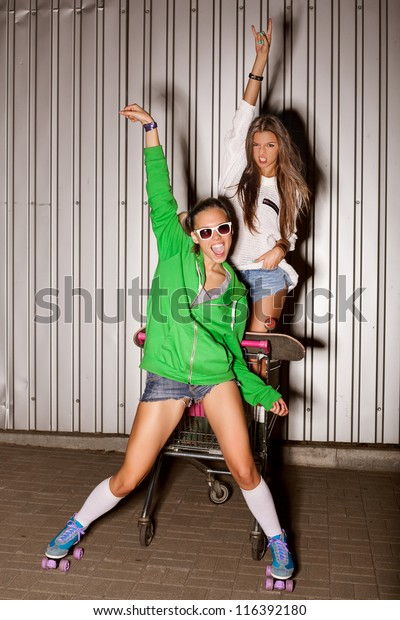 Poartrait Two Naughty Girls Shopping Cart Stock Photo Edit Now