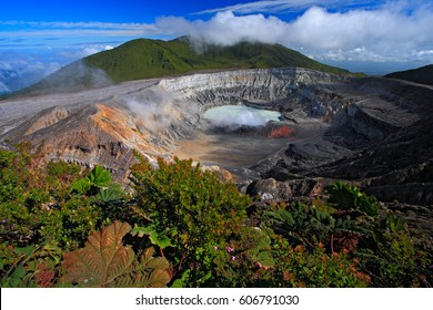 Poas volcano in Costa Rica. Volcano landscape from Costa Rica with blue sky with clouds. Hot lake in the crater Poas. The crater and the lake of the hill Arenal.