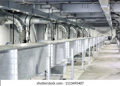 Pocatello, Idaho, USA July7, 2017 An enclosed conveyor with hoppers and stainless steel ducting at a high tech, clean, modern food processing facility.