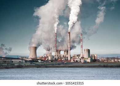 Pocerady – JANUARY 21, 2016: A coal-fired power station in the distance in agricultural landscape. JANUARY 21, 2016, Pocerady, Czech republic
