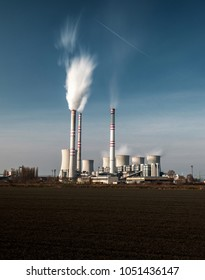 POCERADY – MARCH 18, 2016: A coal-fired power station in the distance in agricultural landscape. MARCH 18, 2016, Pocerady, Czech republic