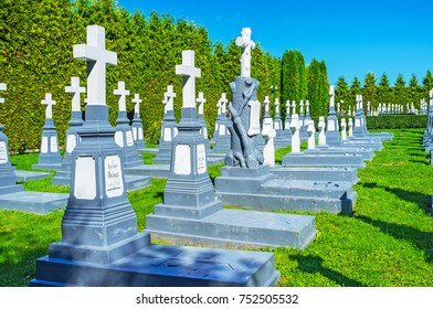 POCHAYIV, UKRAINE - AUGUST 30, 2017: The small and quite monastic cemetery with rows of tombs located next to Pochaev Lavra, on August 30 in Pochayiv.