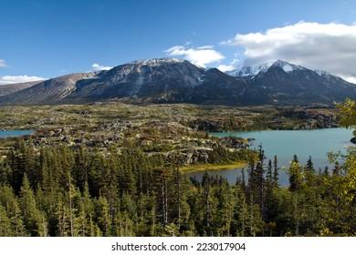 Pocket alpine lakes and rugged rocky terrain, northwestern British Columbia, Canada, north of Skagway, AK