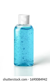 Pocket antiseptic hand sanitizer gel isolated on white background, no label. Small bottle of transparent blue antibacterial liquid with oxygen bubbles, round granules. Hydro alcoholic, ethyl alcohol.