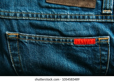 Pocket of blue jeans denim pants closeup.