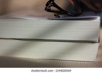 pocket book on fabtic desk with eyeglasses