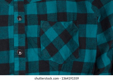 Pocket of checkered black and green textured fabric. Close-up