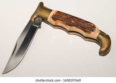 pocket knife with antler and gold grip