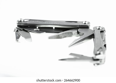 Pocket knife or Steel multi-function tools isolated on white background. Hand tools in industry jobs.
