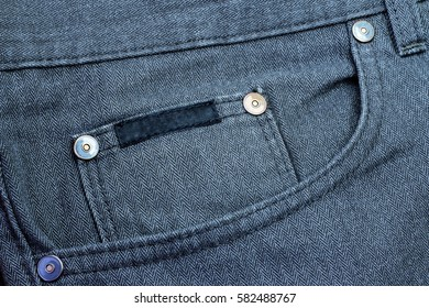 pocket on blue trousers, rivets, color filtered