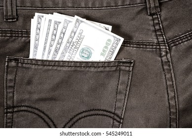 pocket pants stuffed with 100 Dollar bill