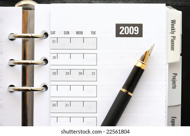 Pocket planner with pen, close up
