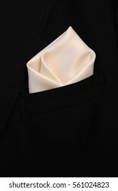 pocket square creamy-white silk - handkerchief in the breast pocket of a man's wool luxury black suit