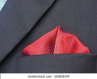 pocket square - handkerchief in the breast pocket of a man's blue wool suit