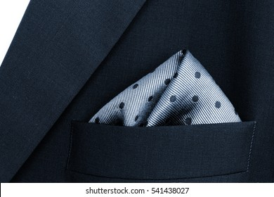pocket square - handkerchief in the breast pocket of a man's blue wool suit, official dress code,