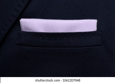 pocket square Purple - handkerchief in the breast pocket of a man's wool luxury dark blue suit
