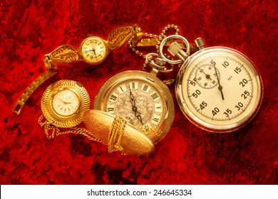 Pocket vintage watch and stopwatch on red