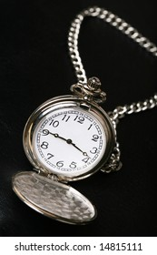 pocket watch with black background