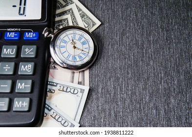 A pocket watch, or clock, timepiece on a pile of cash. Good use for any financial inference where time is a factor of money