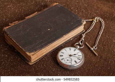 Pocket watch and old Bible