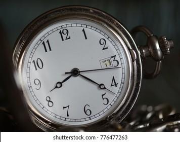 Pocket watch on black background