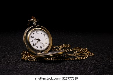 Pocket watch on dark background