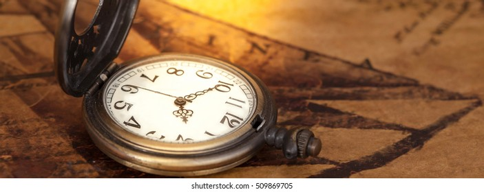 Pocket watch on old map background, vintage style light and tone