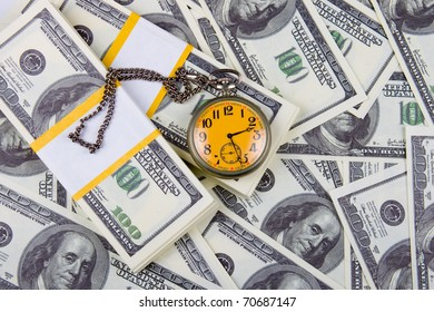 Pocket watch on a stack of dollars, reflecting time and money