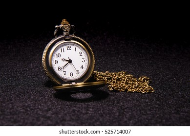 Pocket watch over dark texture