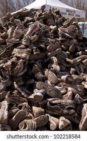 POCONO MANOR, PA - APR 29: A mountain of muddy shoes that were donated after the Tough Mudder event on April 29, 2012 in Pocono Manor, Pennsylvania. The course is designed by British Royal troops.