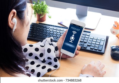 Podcast concept.Female hands holding mobile phone and listening podcast