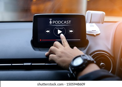 Podcast concept.Hands put at play button on multimedia system in the car