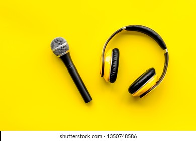 podcast record with microphone and headphones on yellow background top view