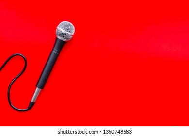 podcast record with microphone on red background top view space for text