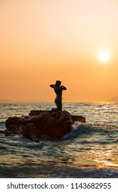 Podgora, Croatia - August 29th, 2017: Mermaid Statue in the sunset on the beach of Podgora, Croatia