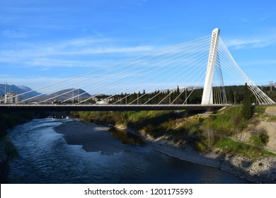 Podgorica/ Montenegro - 04 10 2016: Podgorica Millenium bridge over the Morarca river with blue sky during Easter hollidays