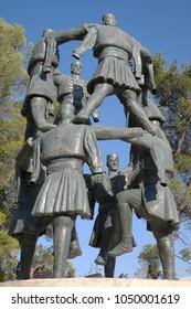 "PODGORICA, MONTENEGRO - AUGUST 13, 2017: ""Sculpture Crnogorsko Oro"" in Podgorica is a statue dedicated to Montenegrin traditional dance"