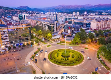 Podgorica Montenegro in the evening. Night cityscape of the capital of a small country in the Balkans, south east Europe. Traffic on roundabout in residential and commercial city center. Aerial view. - Shutterstock ID 1845962032