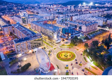 Podgorica Montenegro in the evening. Night cityscape of the capital of a small country in the Balkans, south east Europe. Traffic on roundabout in residential and commercial city center. Aerial view. - Shutterstock ID 1947703195