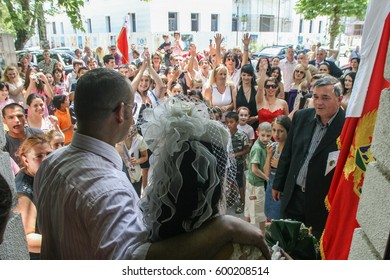 Podgorica, Montenegro, May 24, 2009: A married couple is welcomed by relatives and friends in front of Podgorica City Hall.