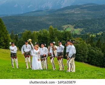 Podhale/Poland - 14/09/2019 High Tatra mountains in Poland. View from Lapszanka near Zakopane. People in traditional outfit having wedding photoshoot in amazing place.