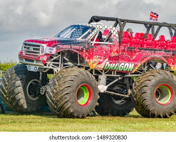 Podington, Bedfordshire, UK – July 18 2019. The Red Dragon monster truck ride where passengers experience the thrills and adrenaline rush of riding in a monster truck